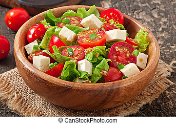 Tomato salad with lettuce, cheese and mustard and garlic...