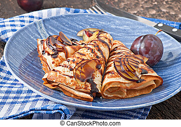 Pancakes with chocolate and plums - Pancakes with chocolate...