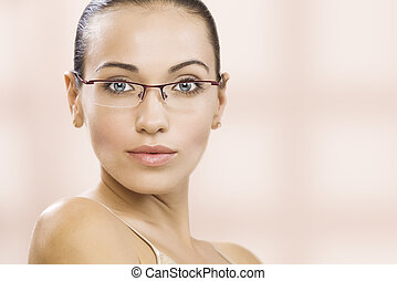 in glasses - Portrait of nice young gorgeous woman on pink...