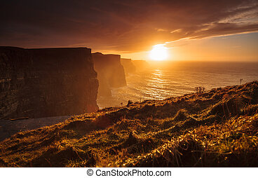 Cliffs of Moher at sunset in Co Clare, Ireland Europe -...