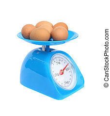 kitchen scales and eggs isolated on white background with...