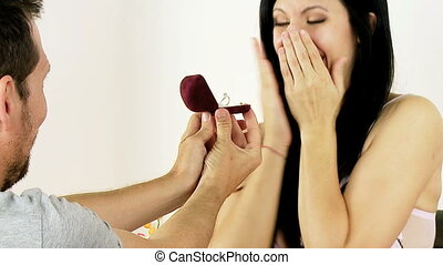Woman getting engagement ring