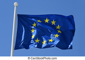 European Union flag flying from a flagpole fluttering in the...