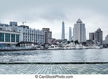 Shanghai Huangpu River, the modern high-rise buildings and...