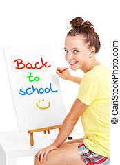 Young girl painting back to school on an easel