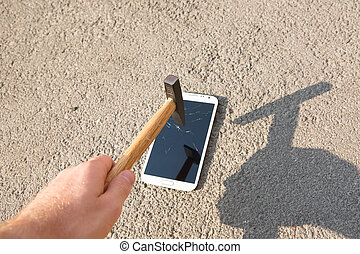 hammer smashing the screen of a smartphone - hammer smashing...