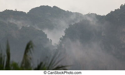 clouds float of tropical mountains