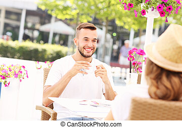 Happy man in a cafe