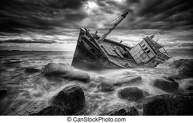 Fishing boat beached in storm in the stone beach, sea,...