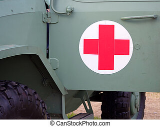 Red cross sign on military vehicle