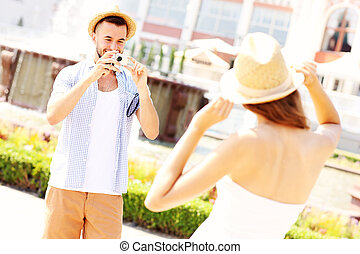 Man taking picture of his girlfriend