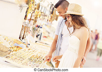 Young couple buying souvenirs - A picture of a young couple...
