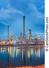 Oil refinery at twilight sky and reflexsion