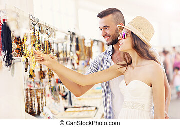 Tourists buing souvenirs - A picture of a young couple...