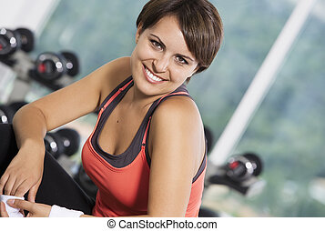 gym portrait - Portrait of young nice woman getting busy in...