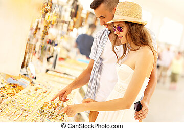 People searching for souvenirs - A picture of a young couple...