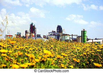 Cement factory - Industry and nature A cement factory behind...