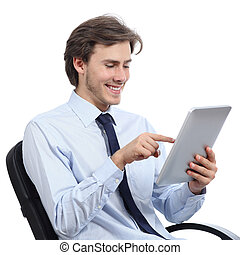 Executive sitting on a chair browsing a tablet isolated on a...