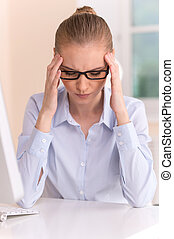 Close up portrait of woman with headache at office. Closeup...