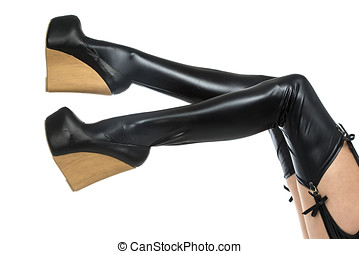 Sexy legs in latex stockings and high heels shoes