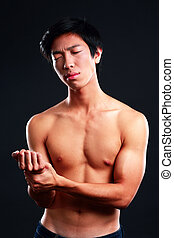 Man checking his pulse by pressing the wrist with fingers