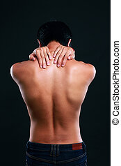 Back view portrait of a man on black background