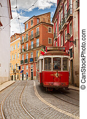 tram on narrow street of Alfama, Lisbon, Portugal