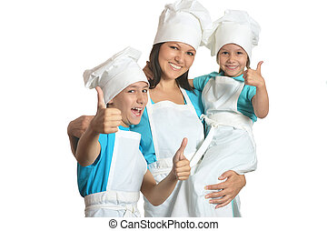 Chef with assistants showing thumbs up - Smiling female chef...