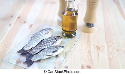 Fresh fish. - Fresh fish with olive oil on the bottle and...