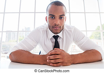 How can I help you Confident young African man in shirt and...