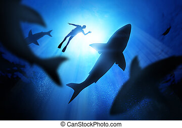 Diver And Great White Sharks - Under the waves a diver with...