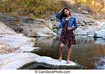 Young Hispanic Woman - Young Hispanic woman near a creek...