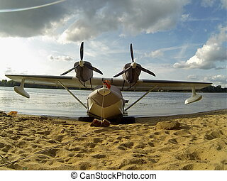 seaplane moored  - Seaplane in the river landscape