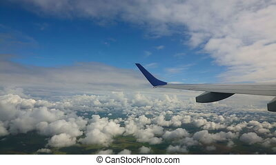 Aerial cloudscape - View from the cabin porthole of an...