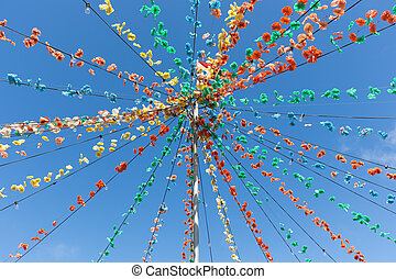 Pole with flower garland decoration at Madeira Island,...