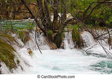 waterfall - small tropical waterfall in rain forest Plitvice...