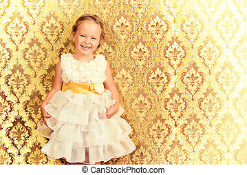 laughing child - Happy little girl in a beautiful white...