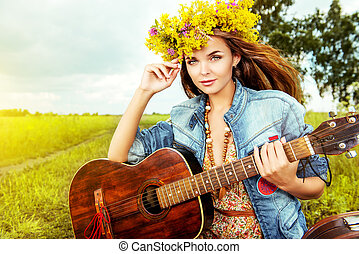 singing a song - Romantic girl in a wreath of wild flowers...