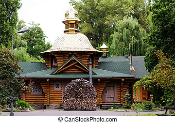 wooden church in the middle of the forest, a pile of chopped...