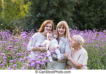 Four generations of women in a beautiful lavender field