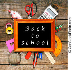 Frame and school tools Vertically Wooden background - Back...