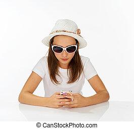 Fashionable yong girl sending an sms - Fashionable yong girl...