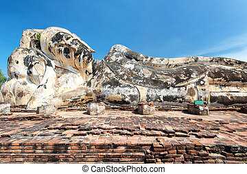 Statue of Reclining (Lying) Buddha in Wat Lokayasutharam,...