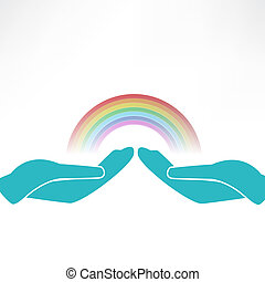 hands on background of the colorful rainbow
