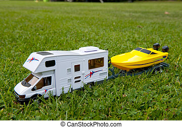 Mobile home with boat on the camping ground