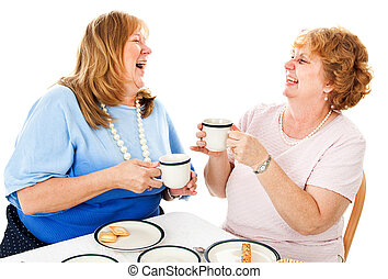 Friends Laughing Over Tea - Two mature ladies having tea...