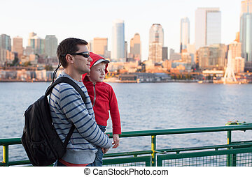 family in seattle - family of two enjoying ferry boat ride...
