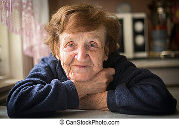 Close-up portrait of an happy old woman