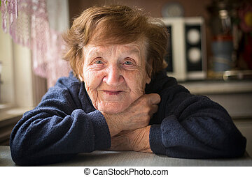 Close-up portrait of an elderly woman in her home