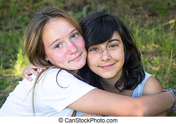 Two young girl in the park having good time.